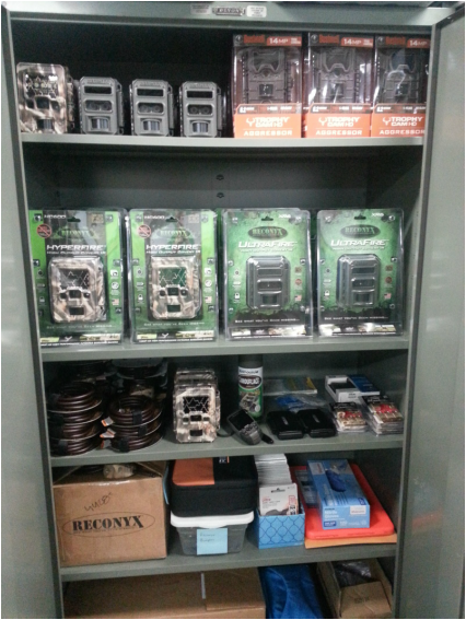 Supply cabinet full of many types of train cameras and locks